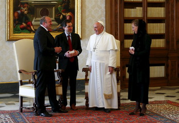 Pope Francis talks with Georgia's President Margvelashvili and his wife Chichua during a private audience in the pontiff's studio at the Vatican