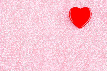 Red heart on a pink background. Romantic background.