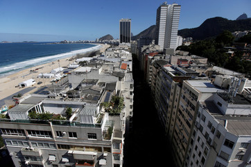 Buildings are pictured in Leme neighborhood with Copacabana beach in the background in Rio de Janeiro