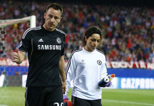 Chelsea's captain John Terry is escorted off the pitch by the team doctor Eva Carneiro after being injured during their Champion's League semi-final first leg soccer match against Atletico Madrid at Vicente Calderon stadium in Madrid