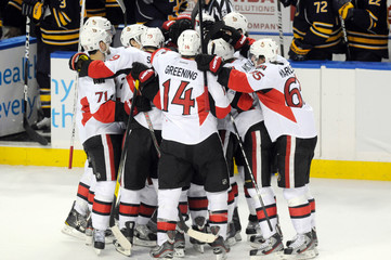 Senators celebrate their shootout victory against the Sabres in Buffalo