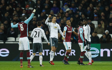 Manchester United's Zlatan Ibrahimovic celebrates scoring their second goal with Paul Pogba and Ander Herrera as West Ham United's Pedro Obiang (R), Winston Reid and Cheikhou Kouyate (L) look dejected