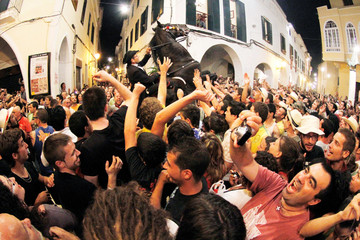 A rider rears up on his horse surrounded by a crowd in downtown Ciutadella during Menorca's traditional Fiesta of San Joan (Saint John)
