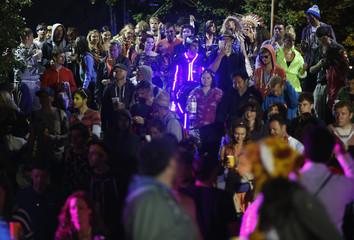 Festival goers walk into Shangri La field at Glastonbury music festival at Worthy Farm in Somerset