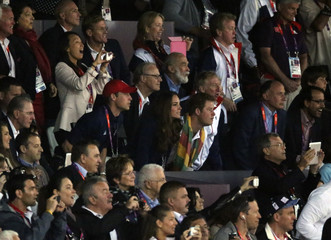 Britain's Prince William (red cap), Catherine, Duchess of Cambridge and Prince Harry watch the men's 100m final at the Olympic Stadium during the London 2012 Olympic Games