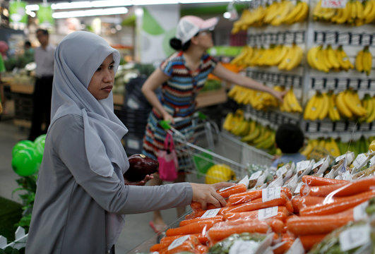 A woman shops for carrots at Foodmart Fresh supermarket in Jakarta