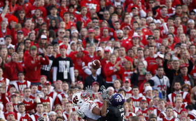 Wisconsin Badger fans watch from the stands as TCU Horned Frogs cornerback McCoy break up a touchdown pass to Wisconsin Badgers Toon during the 3rd quarter at the 97th Rose Bowl game in Pasadena