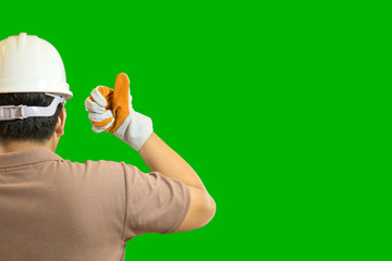 Engineer wearing a white helmet and safety gloves for workers security with green screen background
