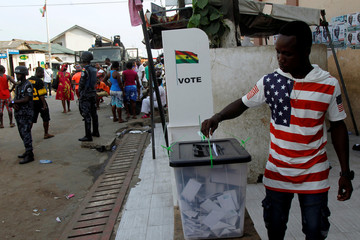 A man casts his vote in Accra during the presidential election