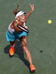 Wozniacki of Denmark hits a return ball to Kvitova of the Czech Republic at the Women's Cincinnati Open tennis tournament in Cincinnati