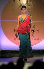Model presents a design as part of an Indian collection at Kenya Fashion Week in the capital Nairobi