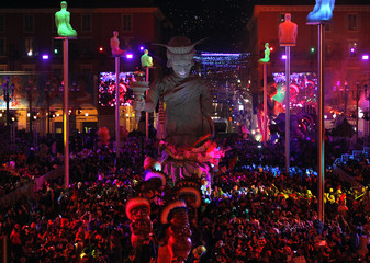 The Statue of Liberty float is paraded through the crowd during the Carnival parade in Nice