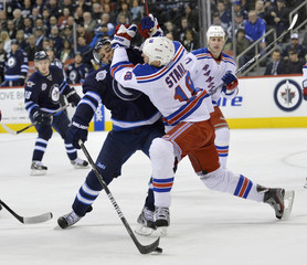 Winnipeg Jets' Kane is checked by New York Rangers' Staal during the second period of their NHL hockey game in Winnipeg