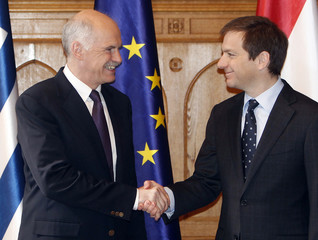 Hungarian Prime Minister Bajnai shakes hands with Greece's Prime Minister Papandreou during a meeting in Budapest