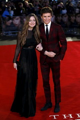 """Cast member Eddie Redmayne poses with this wife Hannah Bagshawe as they arrive for the UK premiere of """"The Danish Girl"""" at Leicester Square in London"""