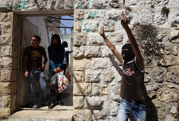 A Palestinian youth gestures in Jerusalem