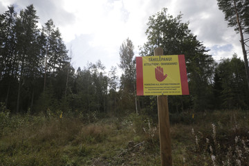 An Estonian warning sign is pictured near the Estonian-Russian border, where, according to Estonia's officials, its security officer was abducted near village of Miikse