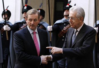 Italian PM Monti shakes hands with his Irish counterpart Kenny in Rome