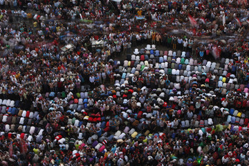Protesters pray during a protest demanding that Egyptian President Mohamed Mursi resign at Tahrir Square in Cairo