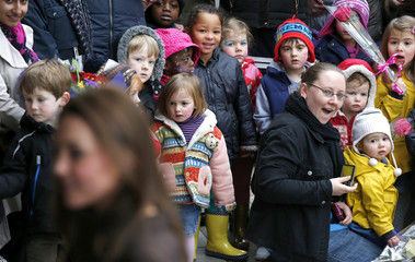 Onlookers react as Britain's Catherine, Duchess of Cambridge arrives at the Fostering Network offices in North London