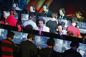 Gamers play video games at the Electronic Arts booth during the 2014 Electronic Entertainment Expo in Los Angeles