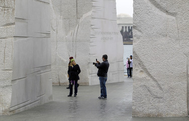 Tourists have their pictures taken at the Martin Luther King, Jr. Memorial in Washington
