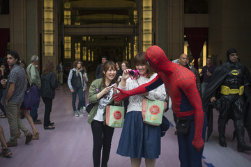 A man dressed as Spiderman greets visitors taking pictures of the preparations for Academy Awards in Hollywood