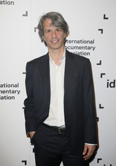 """Director Curry of the best feature award nominee """"Point and Shoot"""" poses at the International Documentary Association's 2014 IDA Documentary Awards in Los Angeles"""