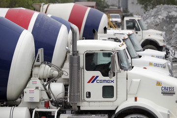 Concrete mixer trucks are lined up at a concrete plant of Mexican cement maker CEMEX, in Monterrey