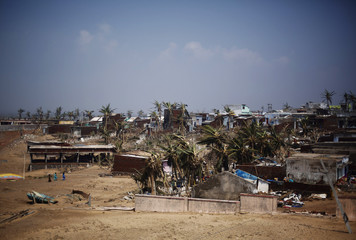 A view of damaged houses is pictured after Cyclone Phailin hit Arjyapalli village