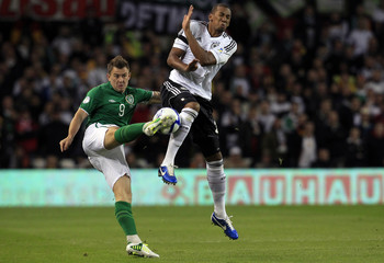 Germany's Jerome Boateng challenges Ireland's Simon Cox during the 2014 World Cup qualifying soccer match at the Aviva Stadium in Dublin