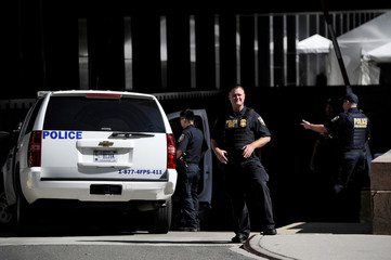 A uniformed officer watches the street as U.S. Republican presidential nominee Donald Trump arrives in the parking garage of a federal building in New York