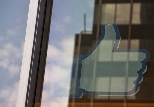 "The Facebook ""Like"" icon is displayed in a window at the offices of J.P. Morgan in New York City"