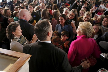 U.S. Democratic presidential candidate Hillary Clinton poses for a photograph with an audience member at a campaign town hall meeting at South Church in Portsmouth, New Hampshire