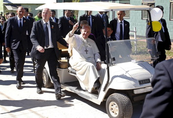 Pope Francis waves as he leaves the Bolivian prison of Palmasola in Santa Cruz, Bolivia