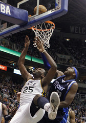 Utah Jazz center Jefferson goes for a shot while defended by Dallas Mavericks center Haywood during the second half of their NBA basketball game in Salt Lake City