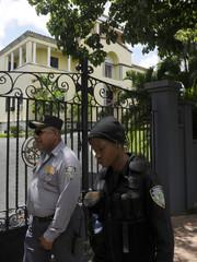 Police officers walk past the Apostolic Nunciature in Santo Domingo