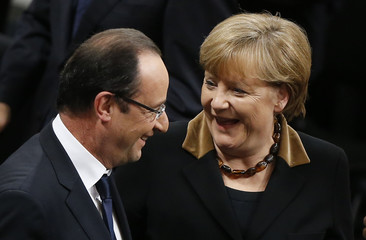 German Chancellor Merkel chats with French President Hollande after joint meeting of German lower house of parliament, Bundestag and French National Assembly in Berlin
