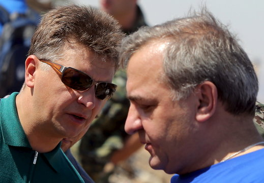 Russian Transport Minister Sokolov talks with Puchkov, Russian Minister for Emergency situations at the crash site of a Russian airliner in the al-Hasanah area in El Arish city, north Egypt