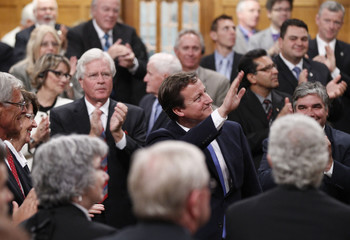 Britain's Prime Minister David Cameron waves after addressing a joint session of Parliament in Ottawa