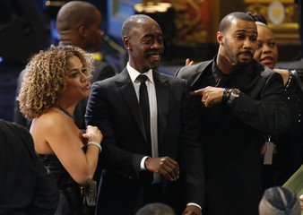 Actor Don Cheadle chats with other attendees at the 47th NAACP Image Awards in Pasadena
