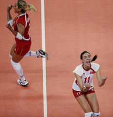 Turkey's players celebrate after defeating Serbia during their women's Group B volleyball match at Earls Court during the London 2012 Olympic Games