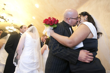 Scott Palmer and Maria St. Clair of Henderson, Nevada, kiss after getting married at the Chapel of the Flowers in Las Vegas