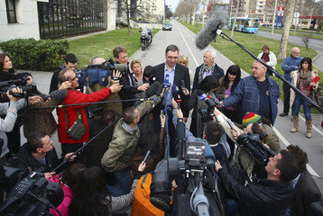 Serbian Deputy Prime Minister and the leader of Serbian Progressive Party Vucic adresses the media in front of a polling station during elections in Belgrade