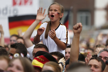 A girl celebrates a goal by Germany at a public viewing of the 2014 World Cup quarter-finals match between Germany and France in Dortmund