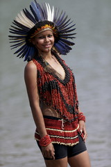 An indigenous woman from Terena tribe poses for photos after participating in a parade of indigenous beauty during the first World Games for Indigenous Peoples in Palmas