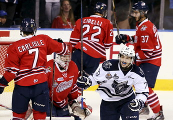 Rimouski Oceanic's Laberge celebrates a goal by team mate Loiseau at the Oshawa Generals net during their Memorial Cup hockey game in Quebec City