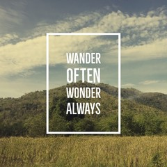"Inspirational motivational quote ""wander often, wonder always"" on mountain background."