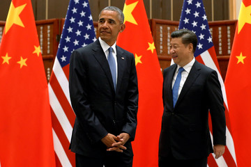 U.S. President Barack Obama and China's President Xi Jinping arrive for a bilateral meeting ahead of the G20 Summit, at West Lake State Guest Housee in Hangzhou West Lake State Guest House