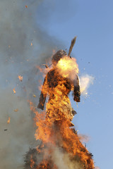 A Boeoegg, a snowman made of wadding and filled with firecrackers, burns atop a bonfire in Sechselaeuten square in Zurich